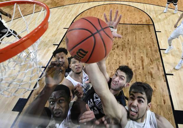 North Carolina's Luke Maye, right, and Gonzaga's Killian Tillie (33) battle for a rebound during the second half in the finals of the Final Four NCAA college basketball tournament, Monday, April 3, 2017, in Glendale, Ariz. (AP Photo/Chris Steppig, Pool)