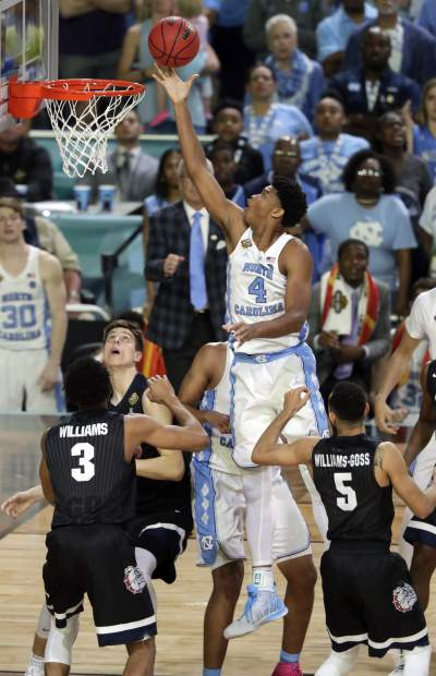 North Carolina's Isaiah Hicks (4) goes uo for a lay up during the second half in the finals of the Final Four NCAA college basketball tournament against Gonzaga, Monday, April 3, 2017, in Glendale, Ariz. (AP Photo/Matt York)