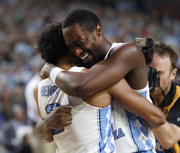 North Carolina forward Theo Pinson, right celebrates with teammate Joel Berry II, left, at the end of the championship game at the Final Four NCAA college basketball tournament, Monday, April 3, 2017, in Glendale, Ariz. North Carolina 71-65. (AP Photo/Charlie Neibergall)