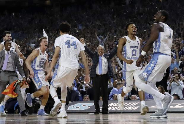 North Carolina head coach Roy Williams and players celebrate after the finals of the Final Four NCAA college basketball tournament against Gonzaga, Monday, April 3, 2017, in Glendale, Ariz. North Carolina won 71-65. (AP Photo/David J. Phillip)
