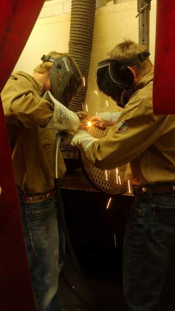 Preston Shuster and Colton Sheridan work on welding in the Rifle High School auto shop.