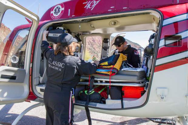 Flight nurse Stacy Lawson, left, and flight paramedic Jeffrey Begay conduct a routine equipment check during the start of their shift.