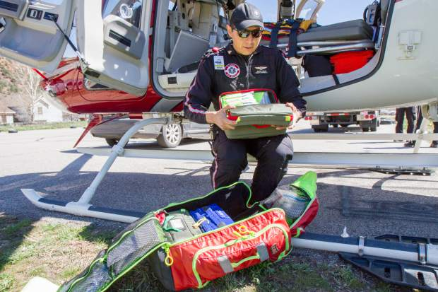 Flight paramedic Jeffrey Begay looks through the Scene Bag which contains everything needed on the scene of a critical emergency.