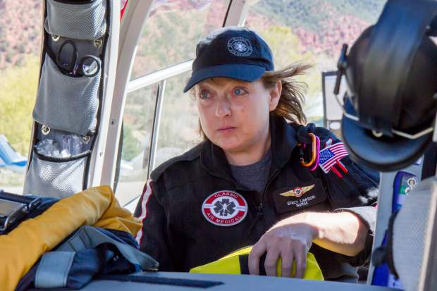 Flight Nurse Stacy Lawson checks on equipment and supplies during a routine check of the helicopter.