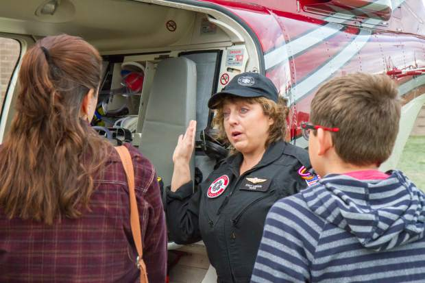 Flight nurse Stacy Lawson gives the pubilc a look inside the Classic Air Medical helicopter during a health fair at Coal Ridge HIgh School.