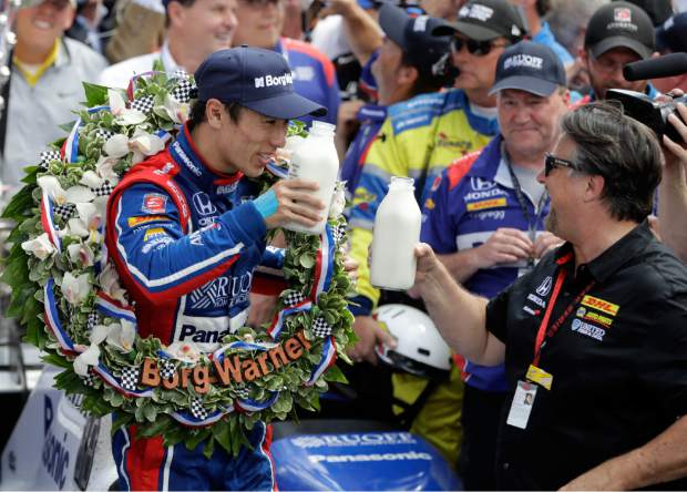 Takuma Sato, left, of Japan, toasts with car owner Michael Andretti as they celebrate after winning the Indianapolis 500 auto race at Indianapolis Motor Speedway, Sunday, in Indianapolis.