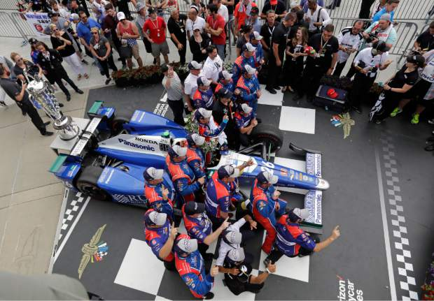Takuma Sato, of Japan, celebrates with his crew after winning the Indianapolis 500 auto race at Indianapolis Motor Speedway, Sunday, May 28, 2017 in Indianapolis. (AP Photo/Darron Cummings)