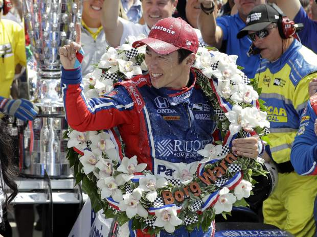 Takuma Sato, of Japan, celebrates winning the Indianapolis 500 auto race at Indianapolis Motor Speedway, Sunday, May 28, 2017 in Indianapolis. (AP Photo/Darron Cummings)
