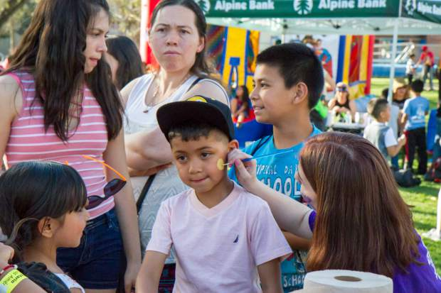 Six-year-old Edgardo Torres gets his face painted with friends at the Festival Las Americas.