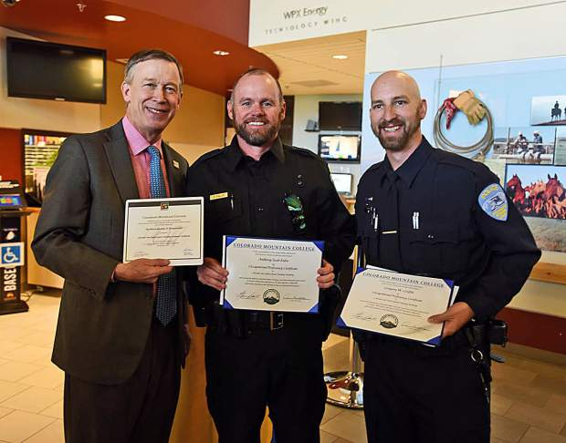 Colorado Gov. John Hickenlooper shows his honorary Colorado Law Enforcement Training Academy certificate alongside certificates of two new CMC CLETA grads: 44-year-old Scott Enloe and Greg Griffin. Enloe will work for the Gunnison County Sheriff's Office and Griffin will join the Steamboat Springs Police Department.