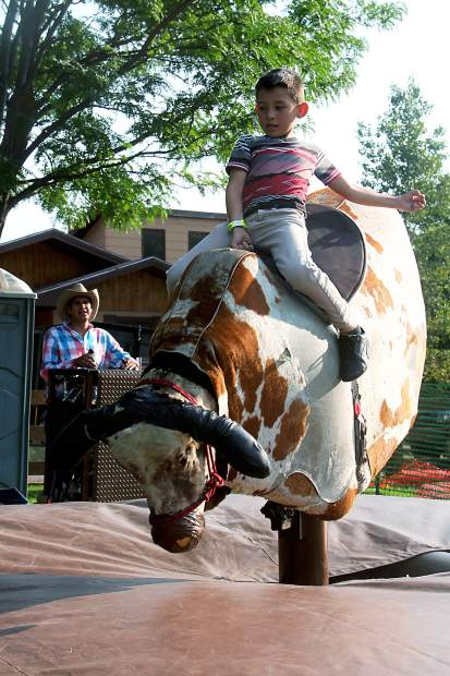 The mechanical bull proved a hit with all ages.