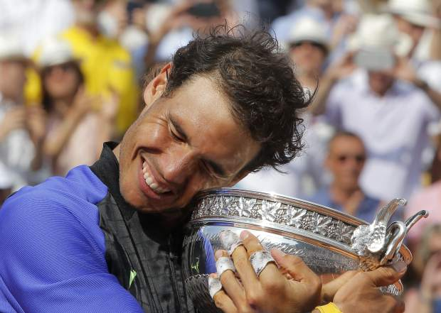 Spain's Rafael Nadal holds the cup after defeating Switzerland's Stan Wawrinka in their final match of the French Open tennis tournament at the Roland Garros stadium, Sunday in Paris. Nadal has won his record 10th French Open title, beating No. 3 Stan Wawrinka in straight sets.