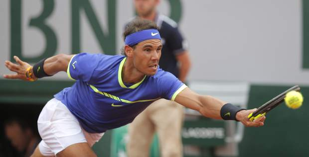 Spain's Rafael Nadal stretches to return the ball to Switzerland's Stan Wawrinka during their final match of the French Open tennis tournament at the Roland Garros stadium, Sunday, June 11, 2017 in Paris. (AP Photo/Michel Euler)