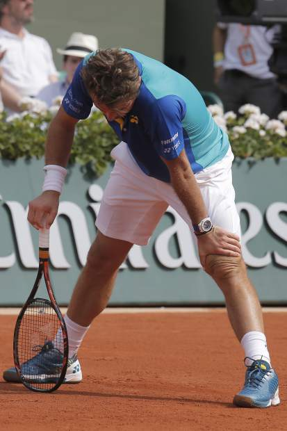 Switzerland's Stan Wawrinka reacts as he plays Spain's Rafael Nadal during their final match of the French Open tennis tournament at the Roland Garros stadium, Sunday, June 11, 2017 in Paris. (AP Photo/Michel Euler)