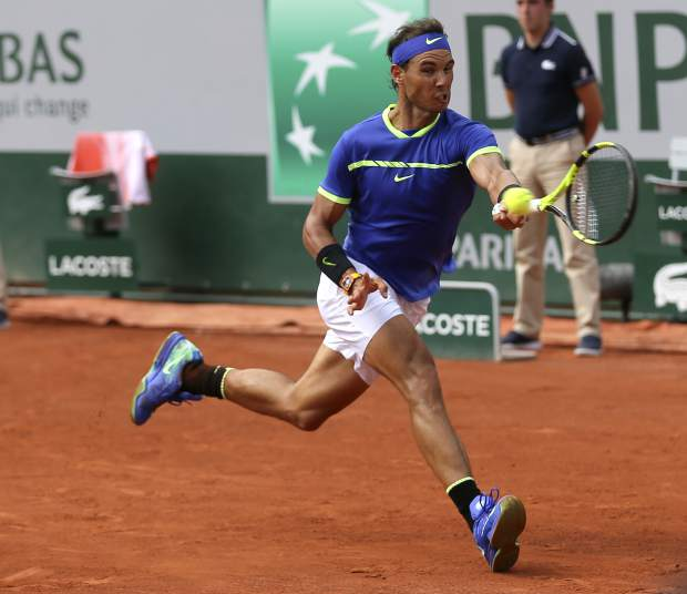Spain's Rafael Nadal returns the ball to Switzerland's Stan Wawrinka during their final match of the French Open tennis tournament at the Roland Garros stadium, Sunday, June 11, 2017 in Paris. (AP Photo/David Vincent)