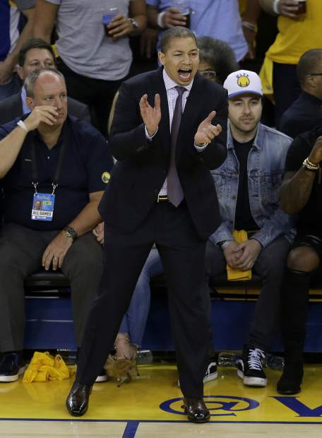 Cleveland Cavaliers head coach Tyronn Lue gestures during the first half of Game 2 of basketball's NBA Finals against the Golden State Warriors in Oakland, Calif., Sunday, June 4, 2017. (AP Photo/Ben Margot)