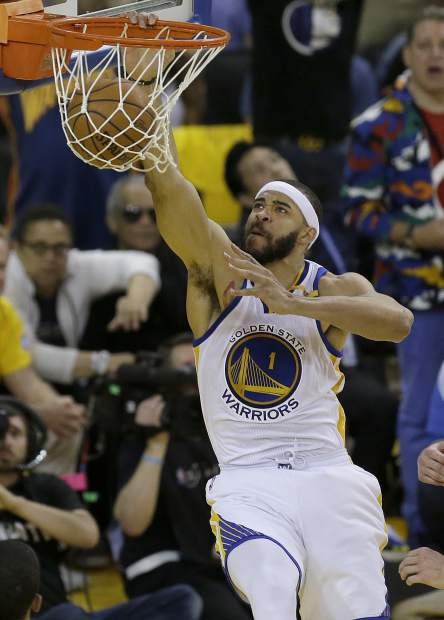 Golden State Warriors center JaVale McGee (1) dunks against the Cleveland Cavaliers during the first half of Game 2 of basketball's NBA Finals in Oakland, Calif., Sunday, June 4, 2017. (AP Photo/Ben Margot)