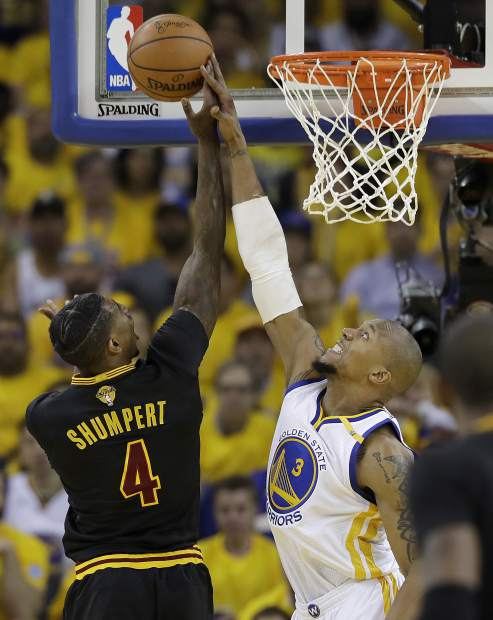 Golden State Warriors forward David West (3) defends a shot by Cleveland Cavaliers guard Iman Shumpert (4) during the first half of Game 2 of basketball's NBA Finals in Oakland, Calif., Sunday, June 4, 2017. (AP Photo/Marcio Jose Sanchez)