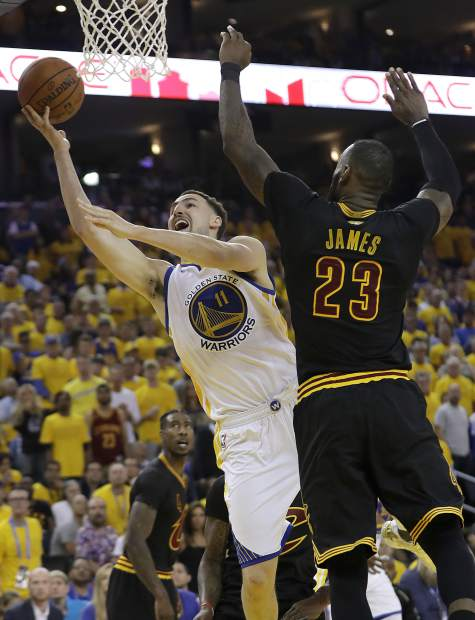 Golden State Warriors guard Klay Thompson (11) shoots against Cleveland Cavaliers forward LeBron James (23) during the first half of Game 2 of basketball's NBA Finals in Oakland, Calif., Sunday, June 4, 2017. (AP Photo/Marcio Jose Sanchez)
