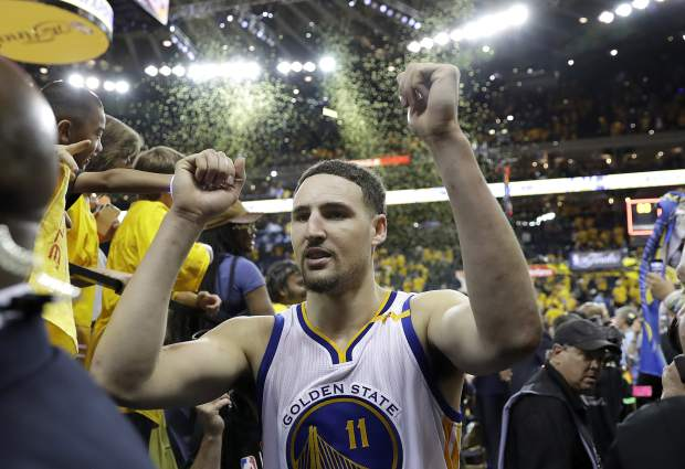 Golden State Warriors guard Klay Thompson (11) walks off the floor after Game 2 of basketball's NBA Finals against the Cleveland Cavaliers in Oakland, Calif., Sunday, June 4, 2017. (AP Photo/Marcio Jose Sanchez)