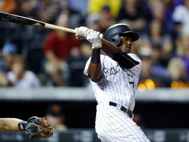 Colorado Rockies' Raimel Tapia watches his walk-off single off San Francisco Giants relief pitcher Hunter Strickland in the ninth inning of a baseball game Thursday, June 15, 2017, in Denver. The Rockies won 10-9. (AP Photo/David Zalubowski)