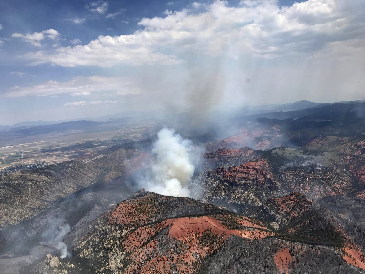 Monday, June 26, 2017, photo provided by the Utah Governor's Office, shows fire activity near Parowan, during a tour by Utah Lt. Gov. Spencer Cox, in southern Utah. The nation's largest wildfire has forced more than 1,500 people from their homes and cabins in a southern Utah mountain area home to a ski town and popular fishing lake.