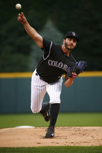 Colorado Rockies starting pitcher Chad Bettis throws to the plate during the first inning of a baseball game against the Atlanta Braves Monday, Aug. 14, 2017, in Denver. (AP Photo/Jack Dempsey)