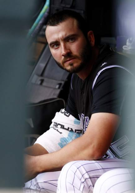 Colorado Rockies starting pitcher Chad Bettis sits in the dugout before a baseball game against the Atlanta Braves, Monday, Aug. 14, 2017, in Denver. The game marks Bettis' first of the year after battling cancer. (AP Photo/Jack Dempsey)