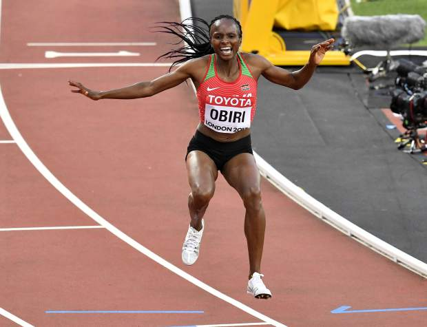 Kenya's Hellen Onsando Obiri celebrates after winning the Women's 5000 meters final at the World Athletics Championships in London Sunday, Aug. 13, 2017. (AP Photo/Martin Meissner)