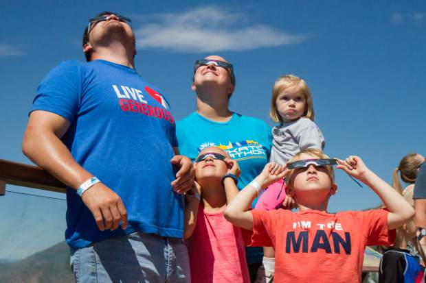 The Alphs family traveled from Minnesota to experience the Great American Eclipse from the viewing deck at the Glenwood Caverns Adventure Park Monday morning.