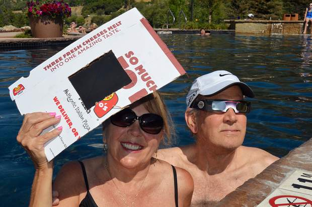 Margie and Ron Hevert were pretty sure they had the best seats in Glenwood to watch the eclipse Monday morning. Lounging in the pool at Iron Mountain Hot Springs, Ron donned a pair of eclipse glasses while Margie used a filter she made from a welding shield and pizza box.