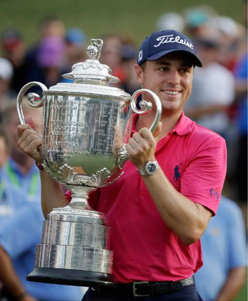 Justin Thomas poses with the Wanamaker Trophy after winning the PGA Championship golf tournament at the Quail Hollow Club Sunday, in Charlotte, N.C.