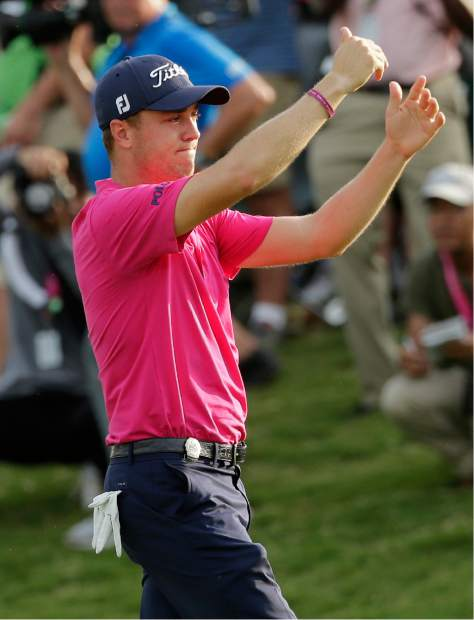 Justin Thomas celebrates after the final round of the PGA Championship golf tournament at the Quail Hollow Club Sunday, Aug. 13, 2017, in Charlotte, N.C. (AP Photo/Chuck Burton)