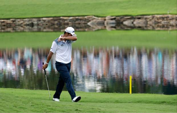 Hideki Matsuyama of Japan, walks up the 18th hole during the final round of the PGA Championship golf tournament at the Quail Hollow Club Sunday, Aug. 13, 2017, in Charlotte, N.C. (AP Photo/John Bazemore)