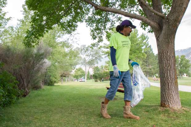 Matthew Hernanadez scavenges for trash Two Rivers Park Saturday morning during the RiverFest clean up.