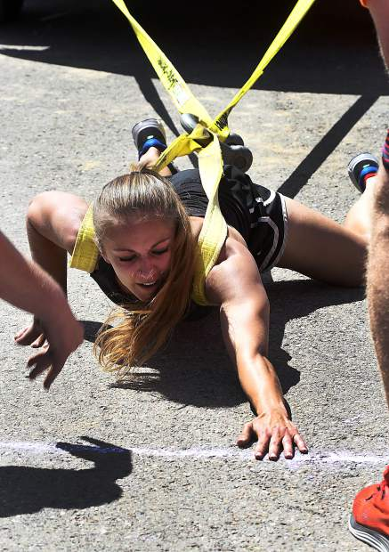 Rachel Orosz of Glenwood Springs lunges for the finish line in the truck pull event in Sunday's Strongman competition at the Garfield County Fair.