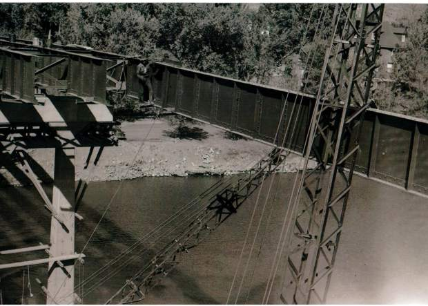 Crews walk thin ledges during the construction of the current Grand Avenue Bridge in 1953.