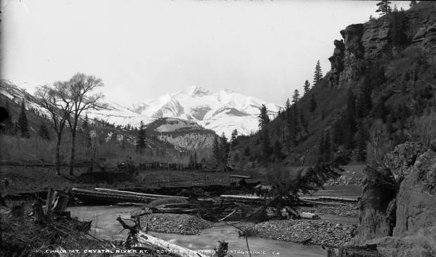 This photo was taken around 1899 just upstream from the north Redstone Bridge. The railroad and wagon road used the old Ute Trail path on the east side of the Crystal River. On the left side, the Elk Mountain Railroad grade is seen along what became Highway 133.
