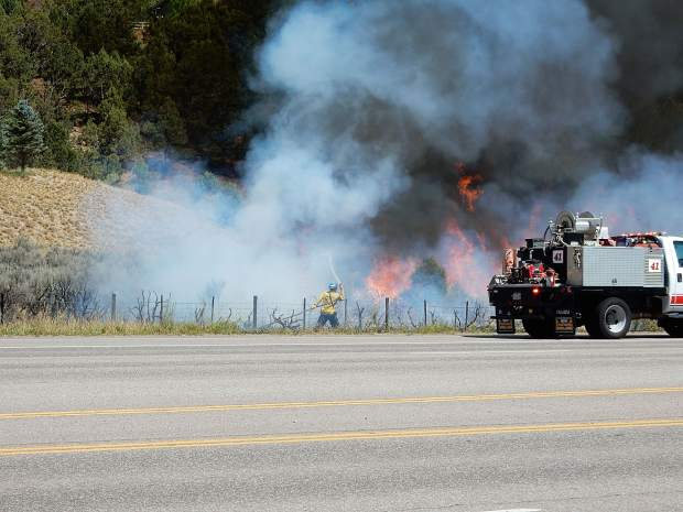 Basalt firefighters and a brush truck arrive on the scene to begin controlling the flames shortly after 2 p.m. Friday.