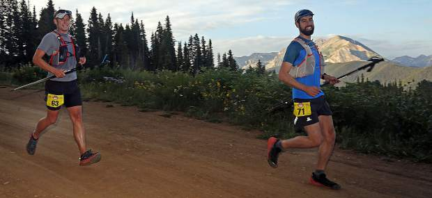 Indiana's Brandon Shaw, left, and Kentucky's Joshua Velazquez make their way down the backside of Aspen Mountain on Sunday during the Audi Power of Four 50k ultra.