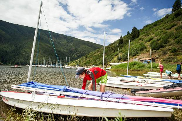Spencer Perley, 14, rigs his sunfish boat before heading out to race on Ruedi Reservoir on Tuesday.