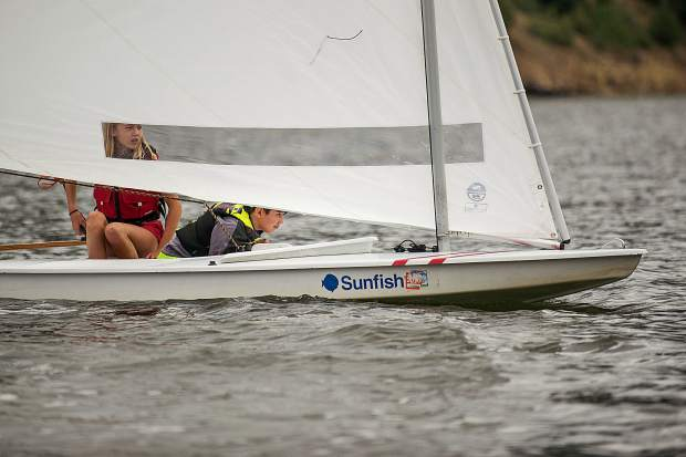 Hope White, 12, and Noah Incze, 10, racing their sunfish on Tuesday on Ruedi Reservoir.