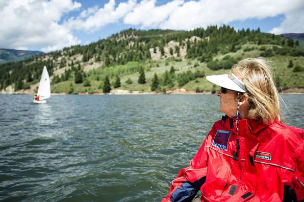 Jill Sheeley watches sailing races for the Don Sheeley Sailing School on Ruedi Reservoir on Tuesday.