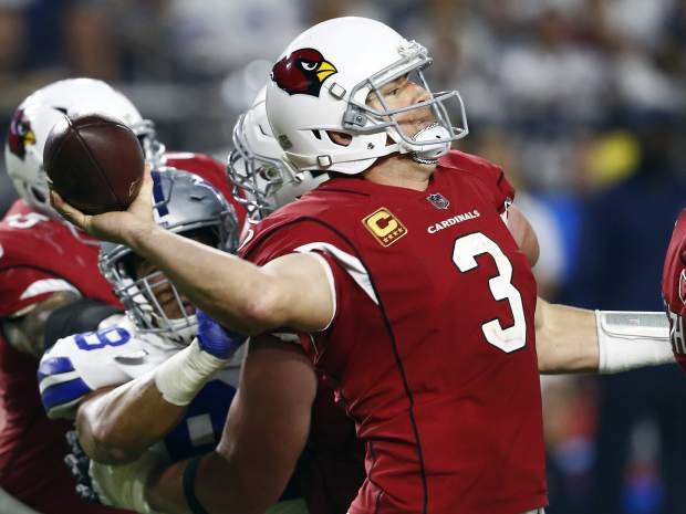 Arizona Cardinals quarterback Carson Palmer (3) throws under pressure from Dallas Cowboys defensive end Tyrone Crawford during the second half of an NFL football game, Monday, Sept. 25, 2017, in Glendale, Ariz. (AP Photo/Ross D. Franklin)