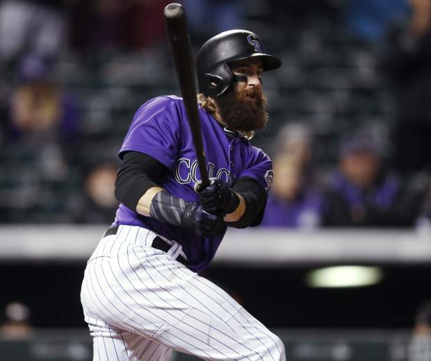 Colorado Rockies' Charlie Blackmon lines into a double play on a pitch from Miami Marlins relief pitcher Kyle Barraclough to end the ninth inning of a baseball game Monday, Sept. 25, 2017, in Denver. Mike Tauchman was doubled off first. Miami won 5-4. (AP Photo/David Zalubowski)