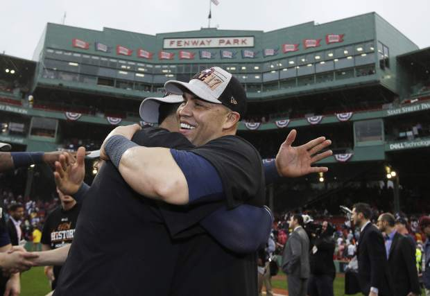 Houston Astros' Carlos Beltran celebrates on the field after the Astros eliminated the Boston Red Sox with a 5-4 victory in Game 4 of baseball's American League Division Series, Monday, Oct. 9, 2017, in Boston. (AP Photo/Charles Krupa)