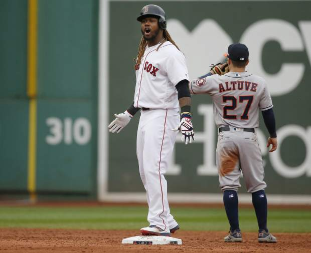 Boston Red Sox designated hitter Hanley Ramirez (13) shouts from second beside Houston Astros second baseman Jose Altuve (27) after his hitting an RBI single and advancing on an error during the third inning in Game 3 of baseball's American League Division Series, Sunday, Oct. 8, 2017, in Boston. (AP Photo/Michael Dwyer)
