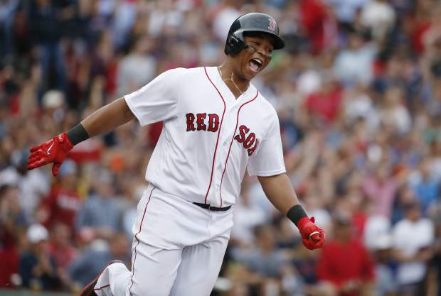 Boston Red Sox's Rafael Devers celebrates his two-run home run against the Houston Astros as he runs the bases during the third inning in Game 3 of baseball's American League Division Series, Sunday, Oct. 8, 2017, in Boston. (AP Photo/Michael Dwyer)