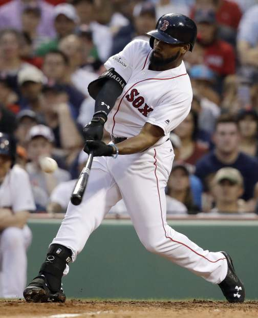Boston Red Sox's Jackie Bradley Jr., hits a three-run home run during the seventh inning of Game 3 of baseball's American League Division Series against the Houston Astros, Sunday, Oct. 8, 2017, in Boston. (AP Photo/Charles Krupa)