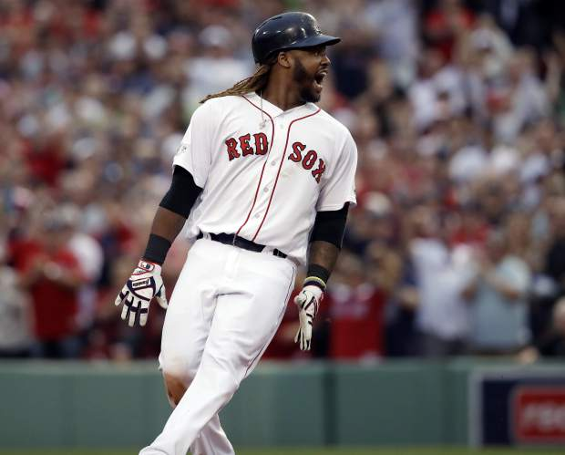 Boston Red Sox designated hitter Hanley Ramirez shouts after hitting a two-run RBI double during the seventh inning in Game 3 of baseball's American League Division Series against the Houston Astros, Sunday, Oct. 8, 2017, in Boston. (AP Photo/Charles Krupa)